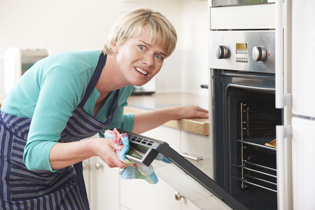 oven door will not open after cleaning cycle
